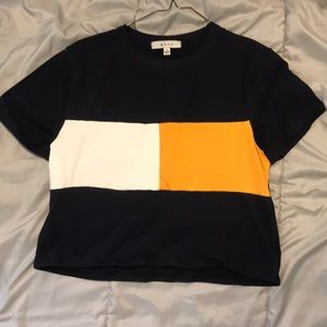 Navy blue crop top with yellow and white stripe